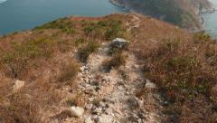 Close POV rocky path in motion, walk downhill along deserted trail Stock Footage