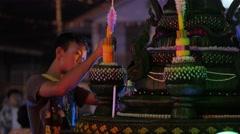 Boy making candle at Ok Phansa Festival,Ubon Ratchathani,Thailand Stock Footage