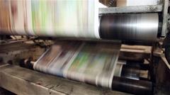 newspaper being printed in a printing press - stock footage