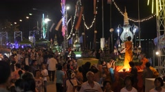 Crowds at Festival with monk fixing candle,Ubon Ratchathani,Thailand Stock Footage