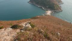 Look down to natural sea washed sand bridge between two islands Stock Footage