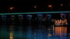 Bridge and lighted boat at Ok Phansa Festival,Ubon Ratchathani,Thailand Stock Footage