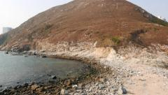 Pan shot of Ap Lei Chau island from small washed sand stripe Stock Footage