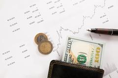 Business diagram on financial report with coins Stock Photos