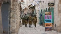 Israeli Soldiers Walk Through Old City in Jerusalem Stock Footage