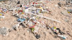 Debris on the very dirty beach, ecological problem, sea pan up many wastes Stock Footage