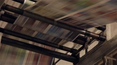 newspaper to be printed and going through printing press - stock footage