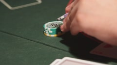 Man playing poker. Playing cards and poker chips - stock footage