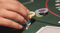 Man playing poker. Playing cards and poker chips Arkistovideo