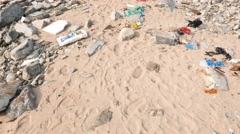 Rubbish lie on sand, camera move close to used mercury tube lamp Stock Footage