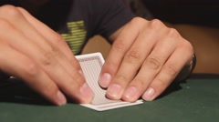 Man playing poker. Playing cards and poker chips Stock Footage