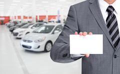 Auto dealer with Business card. Stock Photos