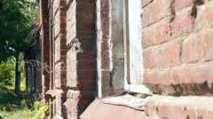 Old red building with large Windows Stock Footage
