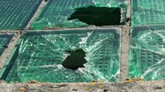 Broken glass pierced by bullet Stock Footage