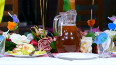 Stock Video Footage of close-up  of table with food cafe restaurant birthday jug of juice