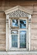 Carved window in old National russian wooden  house Stock Photos