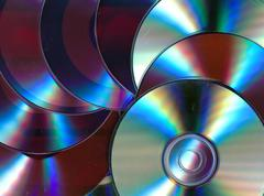 Numerous old DVD discs covered with dust Stock Photos