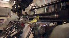 Newspaper being printed on a printing press Stock Footage