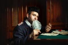 Man wrote the manuscript with quill pen in retro style. Stock Photos