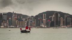 Traditional wooden sailboat sailing in Victoria harbor, Hong Kong. - stock footage