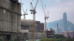 Cranes working on construction site. Stock Footage