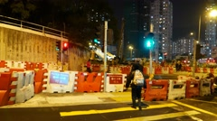 Night road, pedestrian crossing, construction ahead, safety blocks and signs Stock Footage