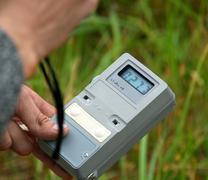 Measuring radiation level - stock photo