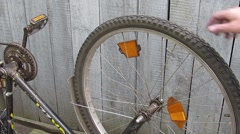 Inverted spinning bicycle wheel - stock footage