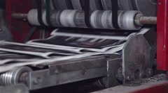 Final stage of newspaper being printed on a printing press Stock Footage