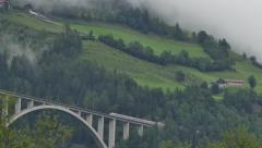 Railway Bridge With Train In Mountains Stock Footage