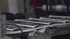 Newspaper in the finals after being printed in printing press Stock Footage