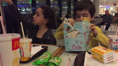 Kids at McDonald's eating fast food Stock Footage