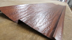 The sheet metal sheets with textured. Сolor brown. Closeup. Dolly. Stock Footage
