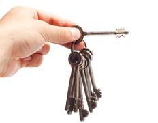 Old rusty bunch of keys in hand Stock Photos