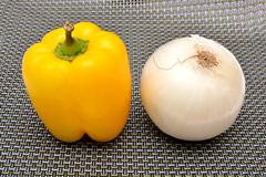 Capsicum Yellow and Onion on background - stock photo
