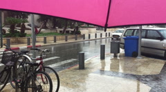 Under an ambrella in the rain Stock Footage