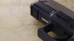 US Constitution with Hand Gun - Right To Keep and Bear Arms - stock footage