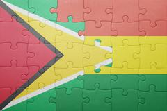 puzzle with the national flag of bolivia and guyana - stock photo