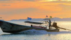 Sunset sunlight on Thailand beach with tourist boat on sea water near Phuket Stock Footage