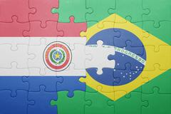 puzzle with the national flag of brazil and paraguay - stock photo