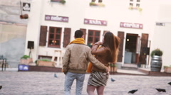 Young couple in love walking through the old city - stock footage