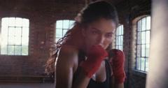 Kickboxing woman training punching bag in fitness studio - stock footage