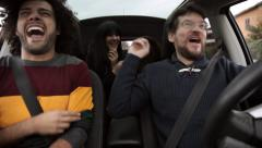 Four friends happy in car having fun Stock Footage