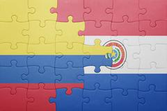 Stock Photo of puzzle with the national flag of paraguay and colombia