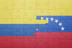 puzzle with the national flag of venezuela and colombia - stock photo