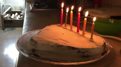 Decorating with candles love shape cake Stock Footage