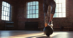 Fitness woman doing toe taps training with medicine ball at gym - stock footage
