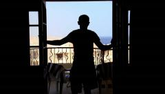 Man opens the curtains and go to the a balcony with sea views Stock Footage