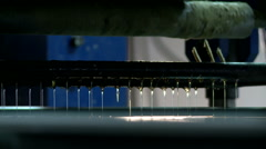 Panel moves along conveyor in gluing process Stock Footage
