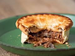 Rustic meat and mushroom pie Stock Photos
